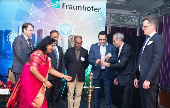 Ms. Anandi Iyer, Director, Fraunhofer Office India lighting the inaugural lamp with other delegates