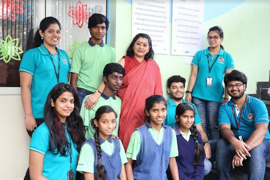 Ms. Shukla Bose, Founder of Parikrma Humanity Foundation, with Parikrma students and muPathshala mentors from Mu Sigma