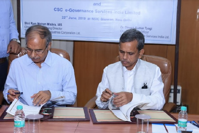 Shri. Ram Mohan Mishra, AS & DC (MSME) & CMD, NSIC signing the MoU with Dr. Dinesh Kumar Tyagi, CEO, CSC e-Governance Services India Limited on 22nd June 2019 at New Delhi