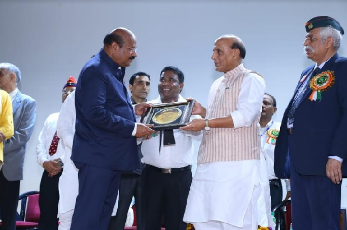Dr. P.C. Rayulu accepting award from Mr. Rajnath Singh