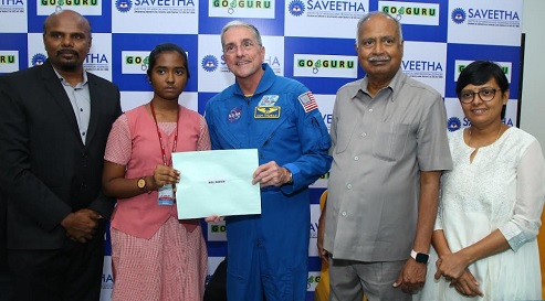 Former NASA Astronaut Dr. Don Thomas handing over the flight ticket to the winner of the National Space Science Contest 2019, Ms. J. Dhaanya Thasnem, (Class X student) of Mahatma Montessori Matric Higher Secondary School, Madurai, to visit NASA 