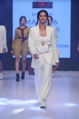 Showstopper Shibani Dandekar in monotone white pant suit from M&S Rethink Autumn Collection'19