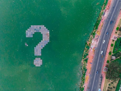 WHY (?) installation by artist Daku on Hussain Sagar Lake