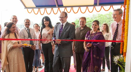 H. E. Sir James David Bevan KCMG, British High Commissioner to India inaugurating the new British School building amidst school officials, parents and students.