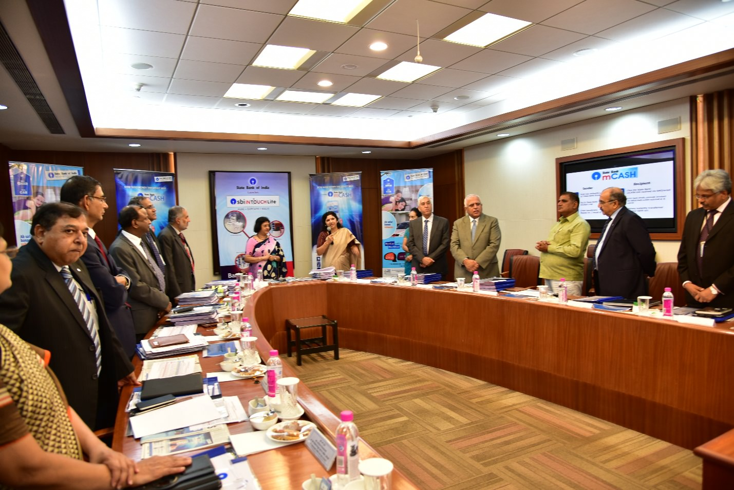 Photo caption: Smt. Arundhati Bhattacharya, Chairman, SBI and top management of the Bank at the launch ceremony of State Bank mCASH.