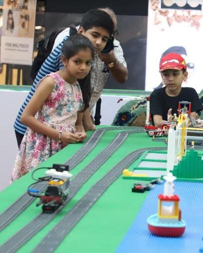 Kids experiencing with India's largest LEGO Landscape at Seawoods Grand Central Mall