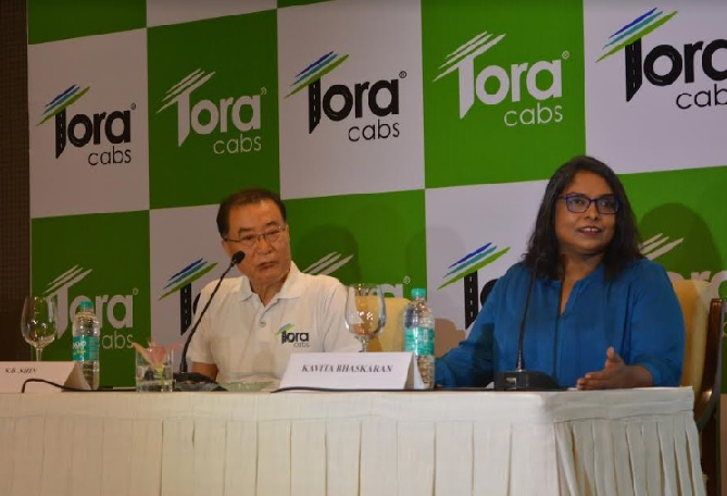 S B Shin, Director, Tora Cabs and Kavita Bhaskaran Ravi, Director Marketing and Public Policy, Tora Cabs announcing Tora's plans to foray into the app based cab hailing sector