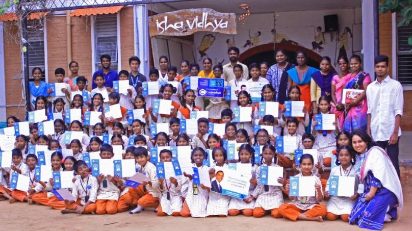 Isha Vidhya children with certificates
