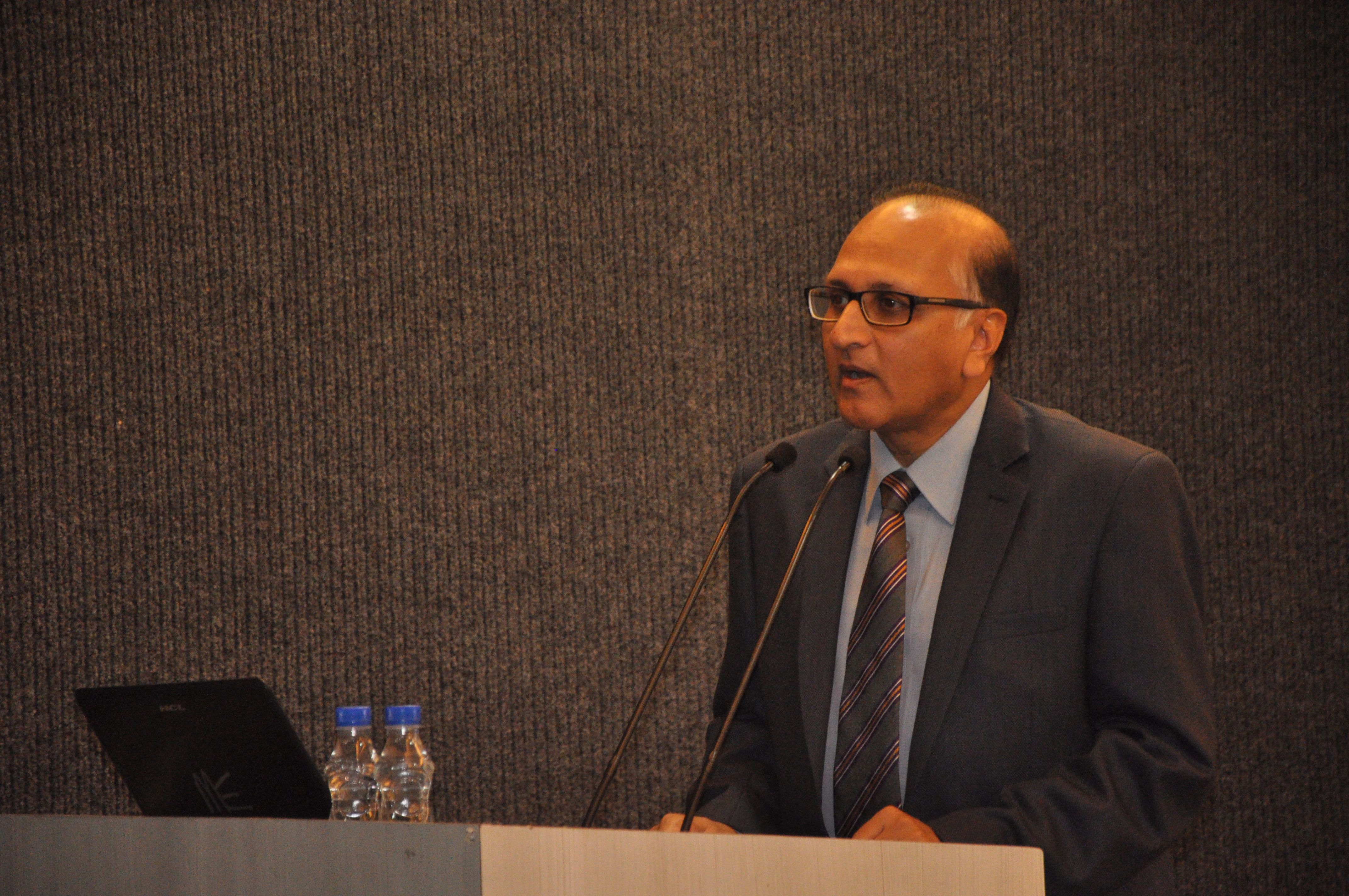 Justice S Ravindra Bhat addressing faculty members from MREI